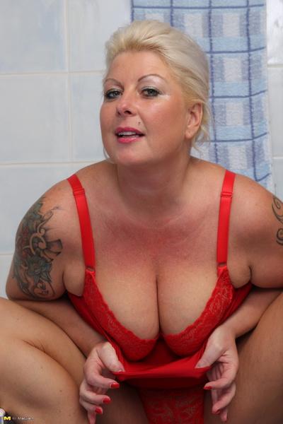 Kinky young slut loves masturbating in the bathtub 6