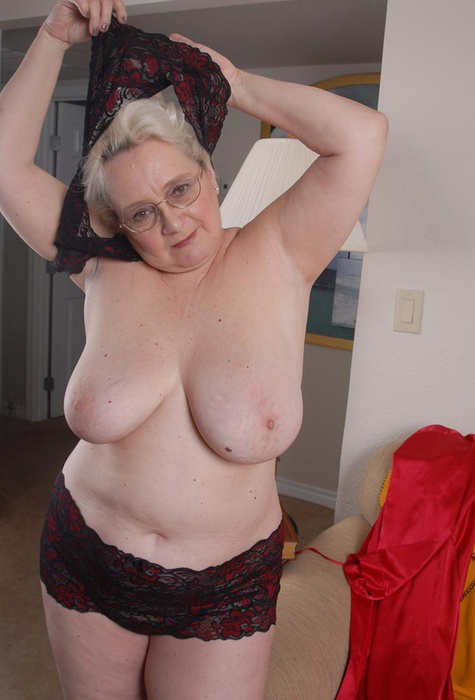 Blonde granny doing herself in the kitchen 5
