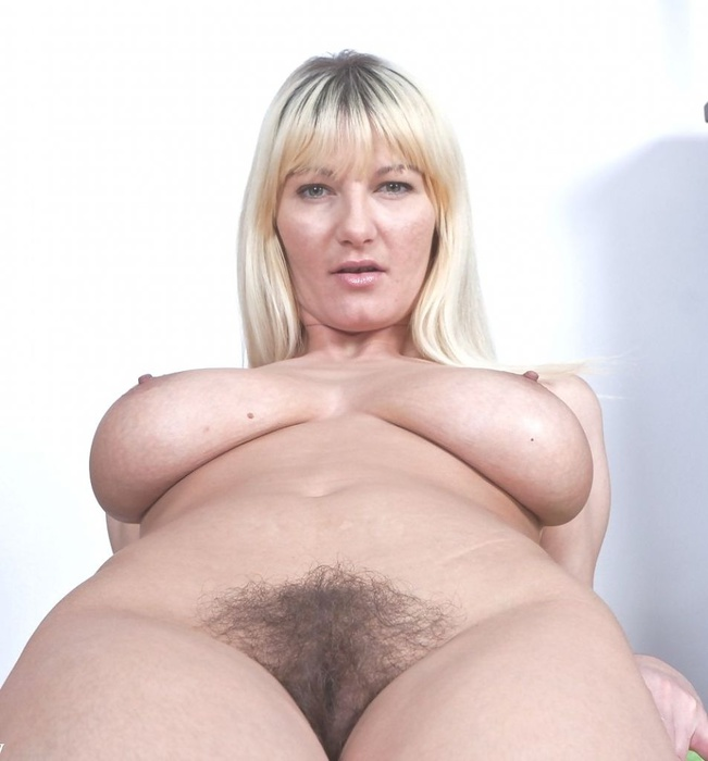 image Big breasted mama playing with her tits and pussy